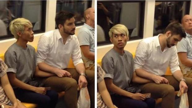 O casal Naparuj Mond Kaendi e Thorsten Mid de mãos dadas no metrô (Reprodução/Facebook)